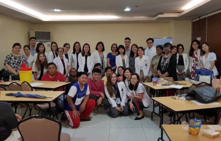 Photo with residents from other PDS institutions and patients from East Avenue Medical Center
